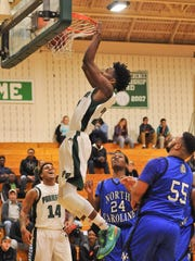 Parkside's Tyrese Purnell throws down a thunderous dunk against North Caroline on Feb. 16, 2016.