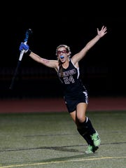 Assumption's Lee Ann Gordon scores the game winning goal in overtime against Manual to win the state field hockey championship.  