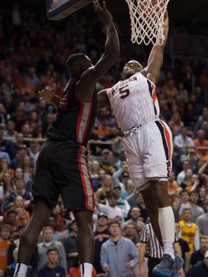 Auburn guard Mustapha Heron (5) dunks around Georgia forward Derek Ogbeide (34) while drawing a foul during the second half of an NCAA college basketball game, Saturday, Jan. 20, 2018, in Auburn, Ala.