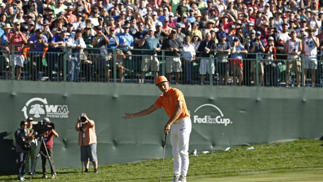 Rickie Fowler reacts after missing a birdie putt on the 16th hole during the final round of the Waste Management Phoenix Open golf tournament at TPC Scottsdale in Scottsdale, Ariz., on Sunday, February 7, 2016.