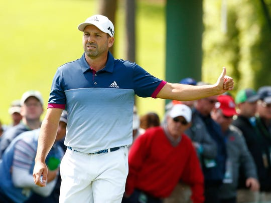 Sergio Garcia gestures as he walks off the 17th tee during the second round of The Masters golf tournament at Augusta National Golf Club.