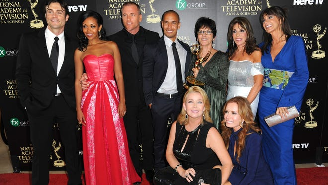 """The cast and crew of ?""""The Young and the Restless?"""" poses in the press room with the award for outstanding drama series at the 41st annual Daytime Emmy Awards at the Beverly Hilton Hotel on Sunday, June 22, 2014, in Beverly Hills, Calif."""