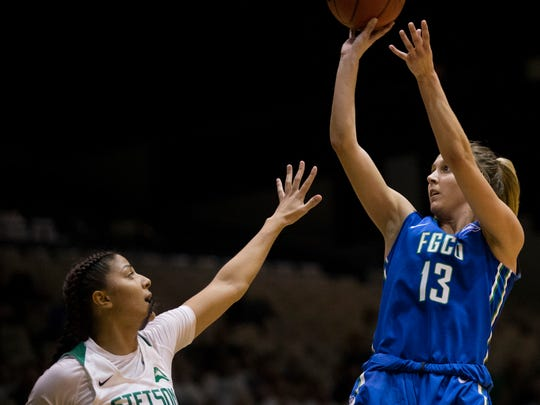 FGCU's Jordin Alexander (13) shoots over Stetson's DeAsia Beal (15) in the second half of action during the Atlantic Sun championship game at the Edmunds Center Sunday, March 12, 2017 in DeLand, Fla. FGCU would win 77-70 to take home the tournament title and an automatic berth to the NCAA tournament.