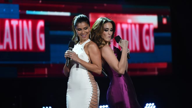 Co-hosts Roselyn Sanchez (L) and Jacqueline Bracamontes perform during the 16th Annual Latin Grammy Awards on November 19, 2015, in Las Vegas, Nevada. AFP PHOTO/MARK RALSTONMARK RALSTON/AFP/Getty Images ORG XMIT: 591731547 ORIG FILE ID: 546577962