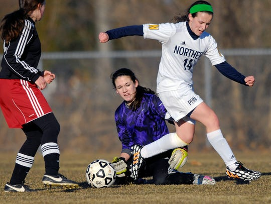 Big Reds' goalkeeper Lily Hurtubise traps the ball