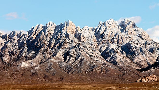 A dusting of snow covers the Organ Mountain.