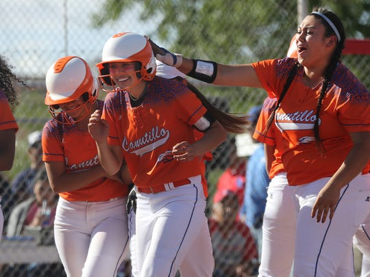 Canutillo's Alexis Hamilton, center left, was congratulated by teammates after clubbing a homerun Friday at Bel Air.