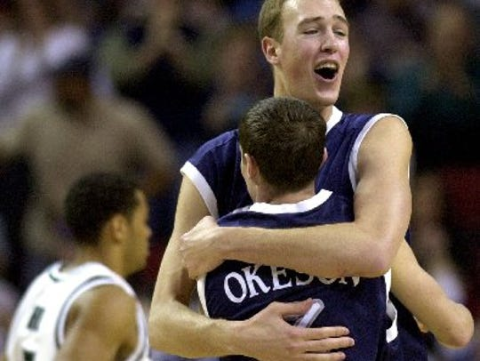 Nick Fazekas hugs teammate (and current Wolf Pack assistant) Todd Okeson following Nevada's upset win over Michigan State in the first round of the 2004 NCAA Tournament.
