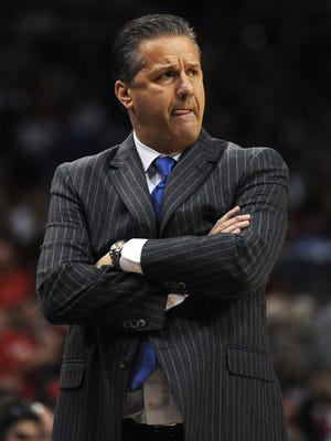 Kentucky head coach John Calipari reacts to a call as the Cats take on UofL on Saturday at the KFC YUM! Center. (By David Lee Hartlage, Special to the C-J) Dec. 27, 2014.