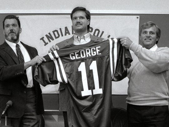 Jim Irsay (left) introduces Jeff George after he signed