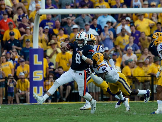 LSU linebacker Devin White 40) tackles Auburn quarterback Jarrett Stidham (8) during the NCAA football game between Auburn and LSU on Saturday, Oct. 14, 2017, at Tiger Stadium in Baton Rouge, La. LSU defeated Auburn 27-23.