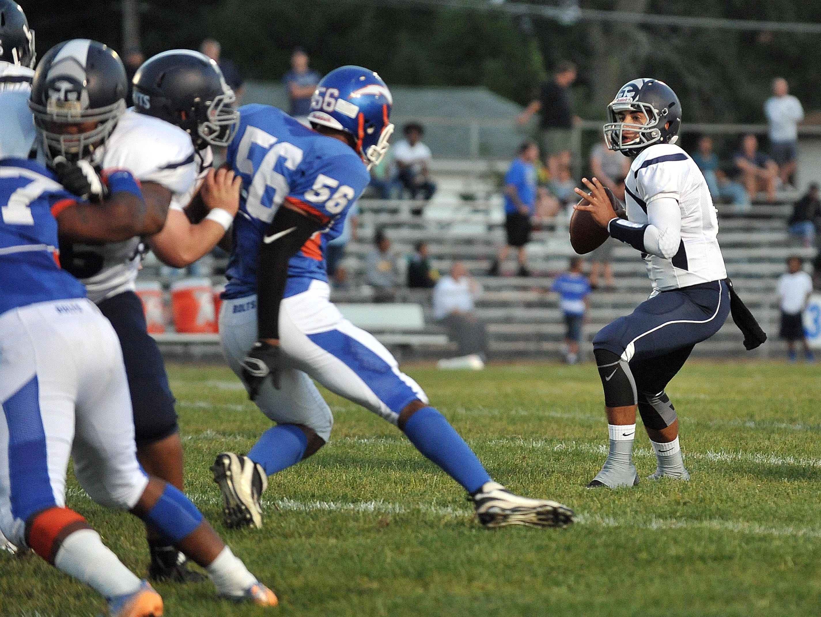 St. Augustine quarterback Jose Tabora (5) looks to throw against Millville, Friday, Sep. 18, in Millville.