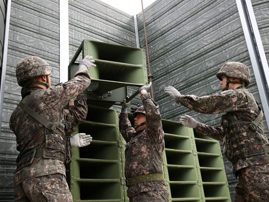 South Korean soldiers take down a propaganda loudspeakers