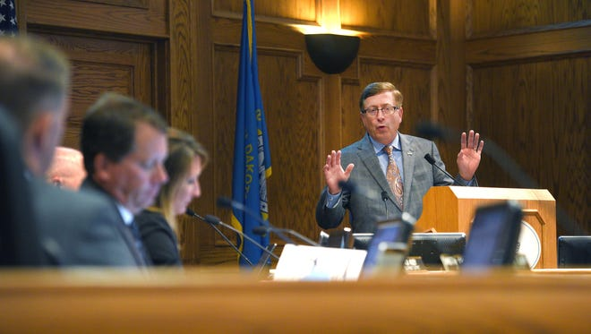 "Mayor Mike Huether gives a presentation titled ""The Reality Check"" Tuesday, July 18, to City Council members at Carnegie Town Hall."