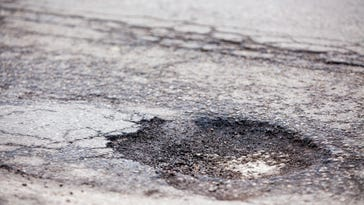 Potholes, 30 mph 'chase' tie up traffic on I-69