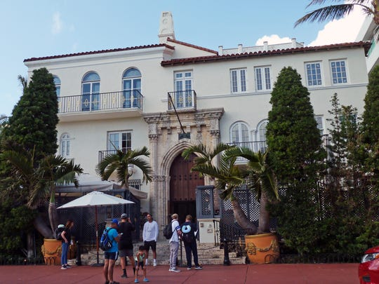 Gianni Versace's Miami Beach mansion on Dec. 26, 2017. It's now a boutique hotel and restaurant where tourists pose in the spot where he was gunned down in 1997.