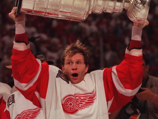 Vladimir Konstantinov takes his turn with the Stanley Cup on June 7, 1997,  after the victory against the Philadelphia Flyers. A week later, Konstantinov was seriously injured in a limousine accident.