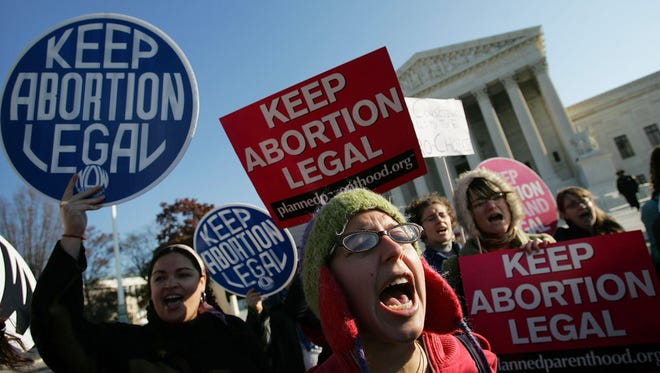 Pro-choice activists chant in front of the U.S. Supreme Court November 30, 2005 in Washington.