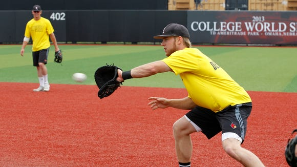 University of Louisville's Grant Kay (7) makes the catch at first base during practice as they get ready to play in their Super Regional game at Jim Patterson Stadium in Louisville, Kentucky, June 5, 2014.