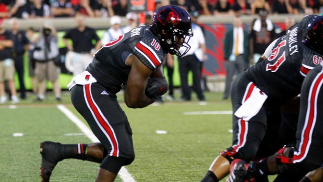 University of Louisville's Dominique Brown (10) runs against the University of Miami during the first half of play at Papa John's Cardinal Stadium in Louisville, Kentucky.       September 1, 2014