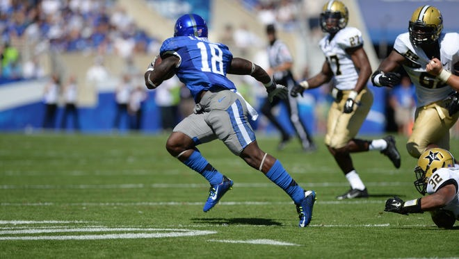 UK running back Stanley Boom Williams breaks around the corner during the first half of the University of Kentucky Football game against the Vanderbilt Commodores in Lexington, KY. Saturday, September 27, 2014.