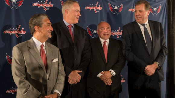 From left, Washington Capitals owner Ted Leonsis, new general manager Brian McLellan, new head coach Barry Trotz and team president Dick Patrick smile during a news conference on Tuesday.
