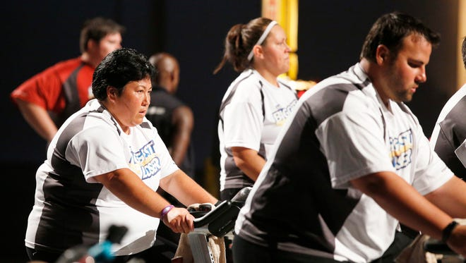 The Biggest Loser contestant Sonya Jones uses the stationary bike to work off her pounds.