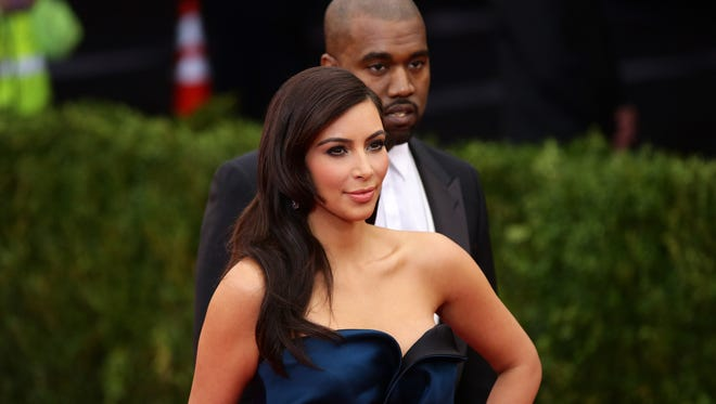 """Kim Kardashian and Kanye West attend the """"Charles James: Beyond Fashion"""" Costume Institute Gala at the Metropolitan Museum of Art on May 5, 2014 in New York City.  (Photo by Neilson Barnard/Getty Images)"""