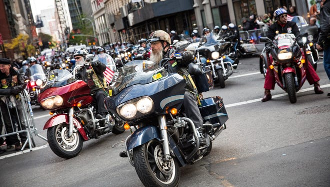 Motorcycle riders participate in the Veteran's Day Parade on November 11, 2013 in New York City.