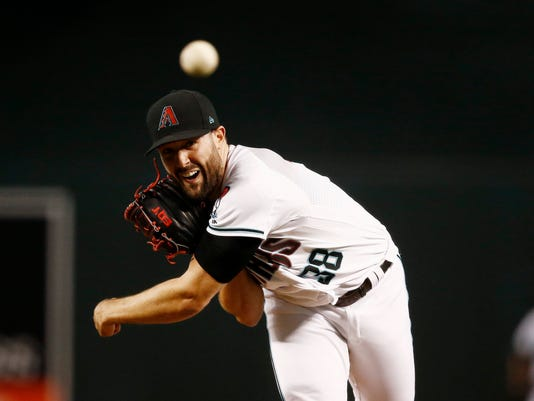 Arizona Diamondbacks' Robbie Ray throws a pitch against the San Diego Padres during the first inning of a baseball game Tuesday, June 6, 2017, in Phoenix. (AP Photo/Ross D. Franklin)