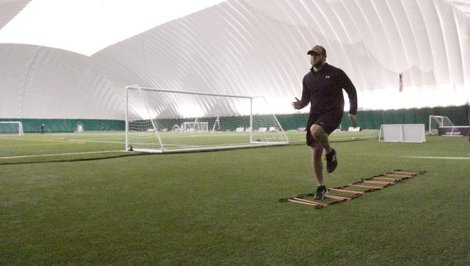 Jimmy Pickens, a minor league baseball player with the Dayton Dragons, works out in the Legacy Center's dome facility.