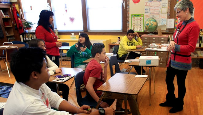 Teacher Brenda Susor (right) teaches English to students during an English Language Learner class at Roosevelt Middle School in Appleton.