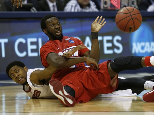 Dayton Flyers' Khari Price (0) steals the ball away against Stanford Cardinal's Chasson Randle (5) during first-half action in the NCAA Tournament's Sweet 16 game at FedExForum in Memphis, Tenn., on Thursday, March 27, 2014. (Nhat V. Meyer/Bay Area News Group/MCT)