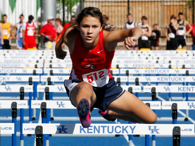 Murray High School's Tina Felix wins the girls 110 Meter Hurdles in the KHSAA Class 1A State Track Meet at the University of Kentucky track facility in Lexington, Kentucky, May 24, 2014.