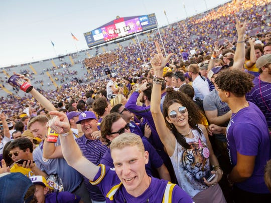 LSU fans rush the field after the Tigers 36-16 win over Georgia in an NCAA college football in Baton Rouge, La., Saturday, Oct. 13, 2018. (AP Photo/Matthew Hinton)