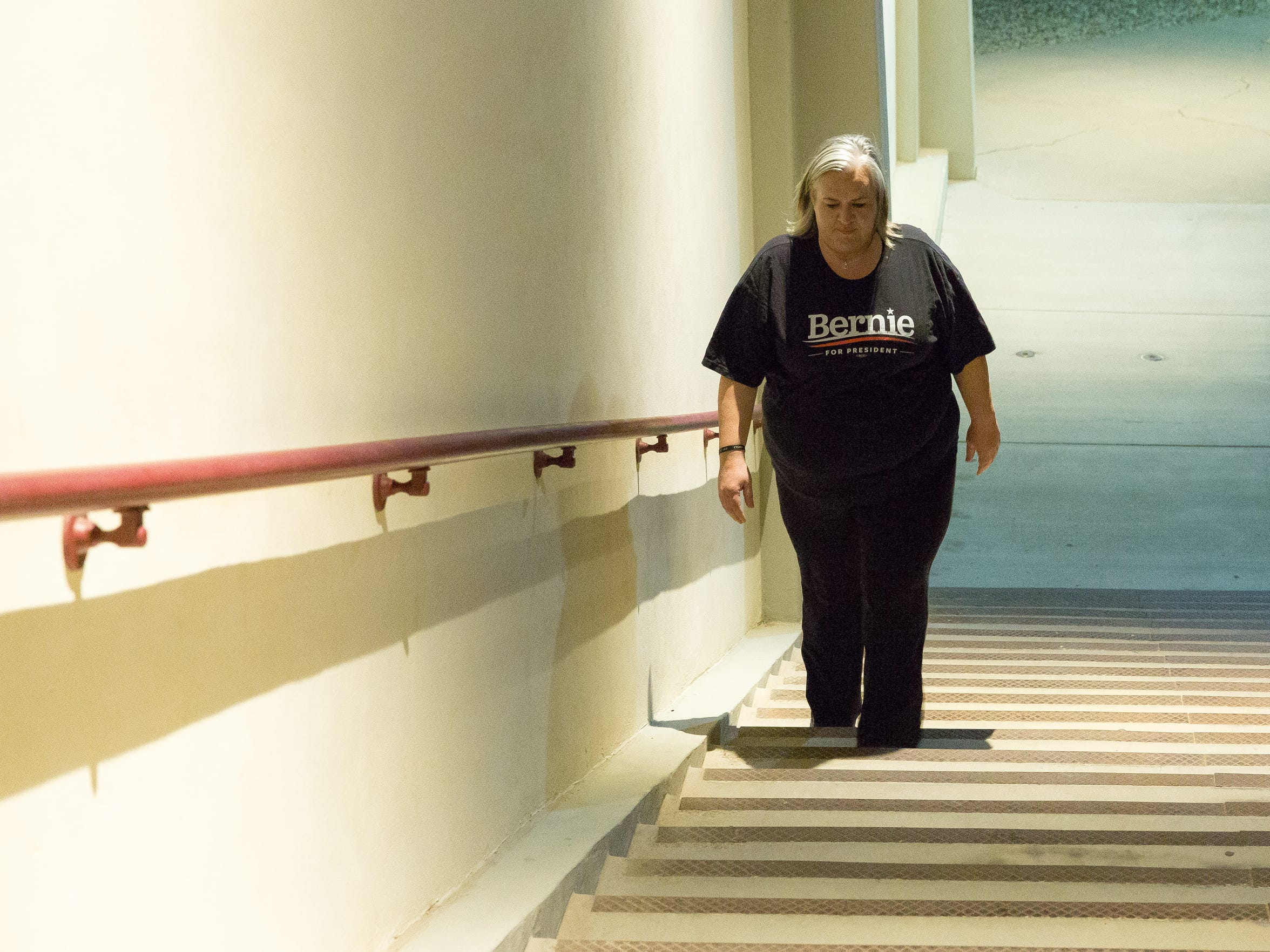 """Sarah Stevens walks the steps of the Pan American Center on Monday, Jan. 16, 2017. """"I get up and I go walking, I have small goals that I set for myself,"""" said Stevens. """"I want to be able to jog a mile by Valentine's Day."""""""