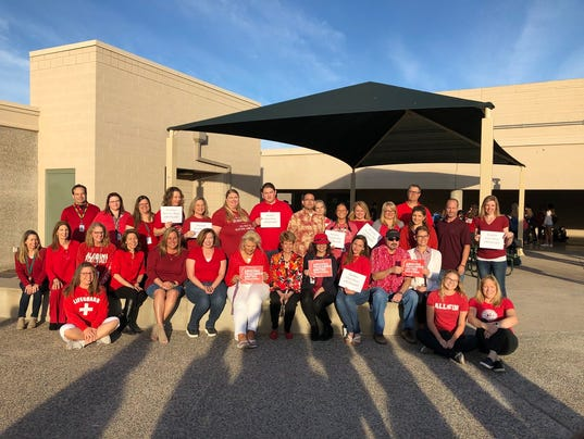 Arizona teachers wear red to protest low pay