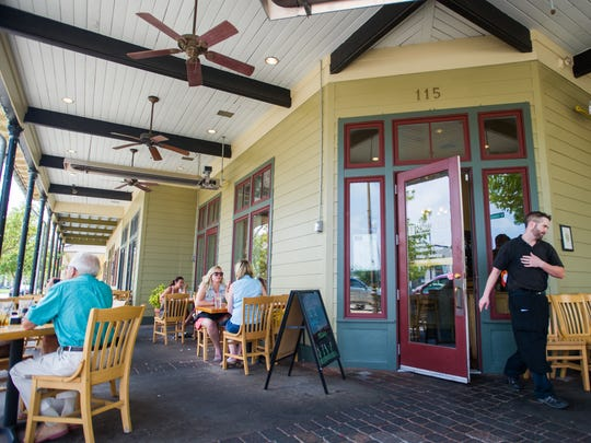 Diners enjoy a casual lunch on the corner patio at