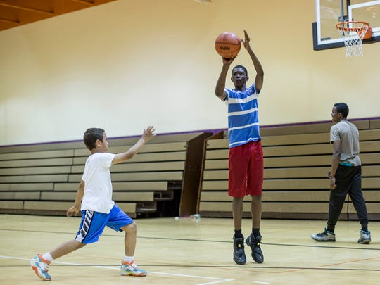 Daveyon Henderson, 13, takes a shot during the Port Huron Basketball Academy Tuesday, May 24, 2016 at the Leonard Center at Cleveland Elementary School.
