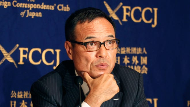 Suntory Holdings President and Chief Executive Officer Takeshi Niinami attends a press conference at the Foreign Correspondents' Club of Japan in Tokyo on Friday, Jan. 15, 2016.