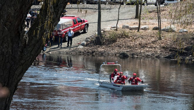Paterson Fire and Rescue on their way to retrieve a reported dead body in the Passaic River on Tuesday, May 1, 2018.