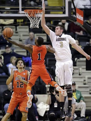Auburn guard Kareem Canty (1) drives against Vanderbilt forward Luke Kornet (3) in the first half of an NCAA college basketball game Tuesday, Jan. 12, 2016, in Nashville, Tenn.