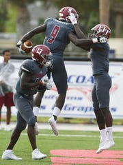 Florida Tech's Kevin Purlett (9) celebrates a touchdown