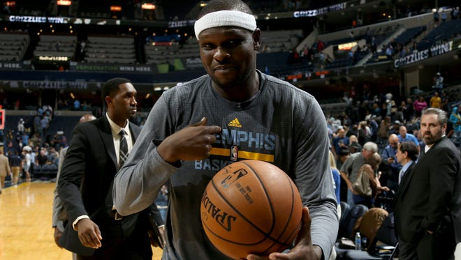 Memphis Grizzlies Zach Randolph exits the court with his game ball for becoming the Grizzlies Franchise leader in field goals made against the New Orleans Pelicans at FedExForum.