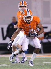 UTEP receiver/running back Warren Redix carries the ball on a hand off against Rice at the Sun Bowl.