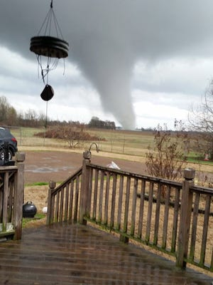 A tornado touches down south of Clarksdale, Miss., on Dec. 23, 2015. At least 11 people lost their lives as tornadoes tore through Texas, authorities said Sunday, as they searched home to home for possible more victims.