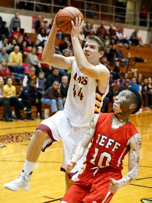 McCutcheon's Gavin Dunbar drives the lane to the basket against Cortiz Buckner of Lafayette Jeff in the boys sectional Friday, March 4, 2016, at Logansport High School. McCutcheon defeated Jeff 62-35.