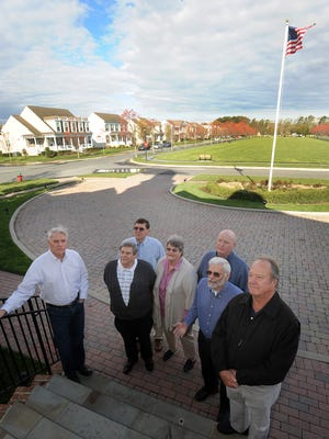 """Members of the Overbrook Town Center Coalition meet at the clubhouse of the nearby Paynters Mill development to discuss the proposed mega-shopping complex. Richard Borrasso, far left, says the proposed center """"is totally out of character for the area."""""""