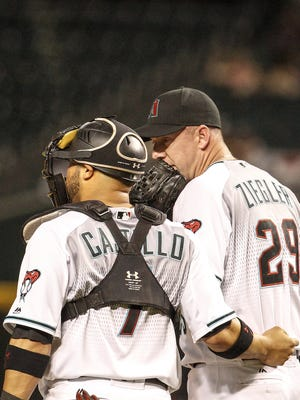 Arizona Diamondbacks Welington Castillo (7) talks privately with Brad Ziegler (29) during a break in the game against the San Diego Padres on July 5, 2016 in Phoenix.