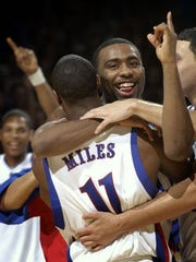 Kansas guard Keith Langford celebrates with guard Aaron Miles (11) after Kansas beat Georgia Tech 70-68 in overtime Saturday, Jan. 1, 2005 at Allen Fieldhouse in Lawrence, Kan. (AP Photo/Charlie Riedel)